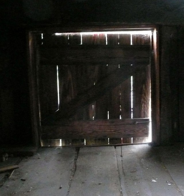 A little door in the loft of my barn -maybe used for hay?