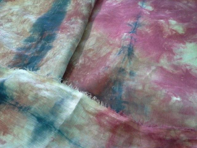 a skirt, a shawl, a blouse, a curtain, a tablecoth, a throw